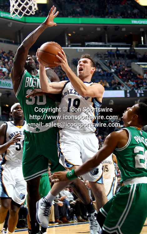 Nov. 21, 2014 - Memphis, TN, USA - The Memphis Grizzlies' Beno Udrih splits the defense of the Boston Celtics' Brandon Bass (30) and Phil Pressey, right, at FedExForum in Memphis, Tenn., on Friday, Nov. 21, 2014. The Grizzlies won, 117-100.