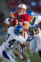 September 19, 2009; Stanford, CA, USA;  Stanford FB Owen Marecic (48) is tackled by San Jose State linebacker Travis Jones (14) after a pass reception in the first quarter of the game at Stanford Stadium.