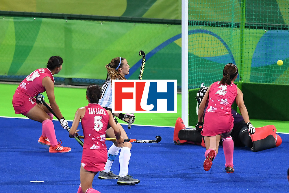Argentina's Carla Rebecchi scores a goal during the women's field hockey Argentina vs Japan match of the Rio 2016 Olympics Games at the Olympic Hockey Centre in Rio de Janeiro on August, 8 2016. / AFP / MANAN VATSYAYANA        (Photo credit should read MANAN VATSYAYANA/AFP/Getty Images)