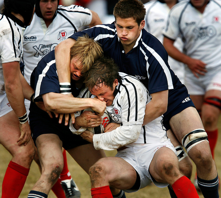 (from left) BYU's Steve St. Pierre and T. J. Allred try to wrestle the ball away from Utah's Tom Bunnell. BYU defeated the University of Utah in Ruby 21-20 at Stillwell Field at Fort Douglas on the U of U Campus in Salt Lake City, Utah , Saturday, March 10, 2007. August Miller/ Deseret Morning News