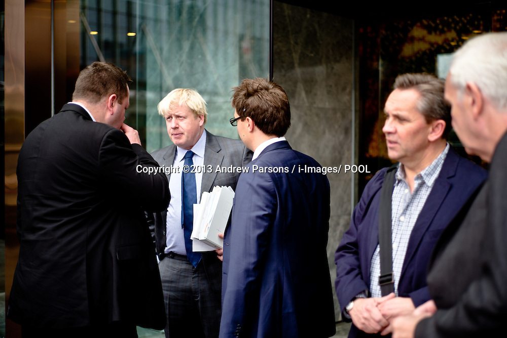 London Mayor Boris Johnson with his staff before the Go Global conference in Shanghai on Day 5 of a  trade mission to China on his 6 day visit to China. Thursday, 17th October 2013. Picture by Andrew Parsons / i-Images/ POOL