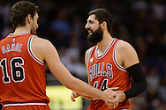 Nov 18, 2015; Phoenix, AZ, USA; Chicago Bulls forward Nikola Mirotic (44) talks with teammate center Pau Gasol (16) on the court in the game against the Phoenix Suns at Talking Stick Resort Arena. The Bulls won 103-97. Mandatory Credit: Jennifer Stewart-USA TODAY Sports