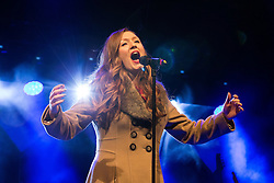 © Licensed to London News Pictures . 07/11/2015 . Manchester , UK . LUCY O'BYRNE performs ahead of the Christmas Lights switch on at Albert Square in front of Manchester Town Hall . Photo credit : Joel Goodman/LNP