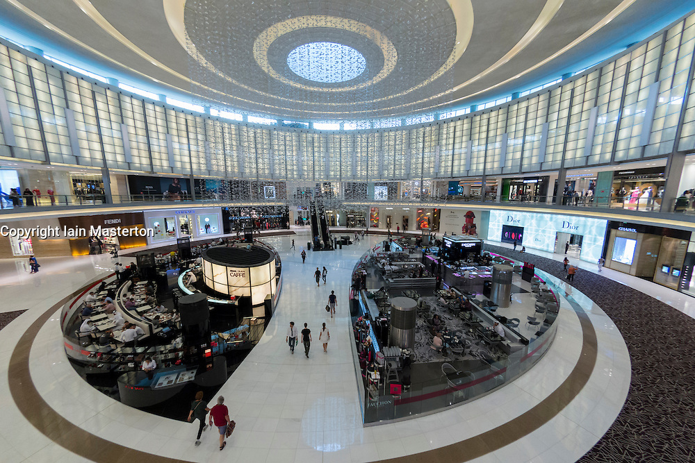 Interior of large atrium at Fashion avenuse with cafes and shops at Dubai Mall in Dubai United Arab Emirates I