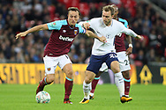 Mark Noble of West Ham United (L) holds off Christian Eriksen of Tottenham Hotspur (R). EFL Carabao Cup, 4th round match, Tottenham Hotspur v West Ham United at Wembley Stadium in London on Wednesday 25th October 2017.<br /> pic by Steffan Bowen, Andrew Orchard sports photography.