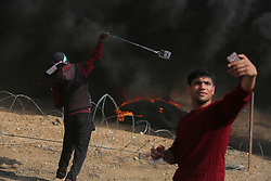 April 27, 2018 - Gaza, gaza strip, Palestine - Palestinian takes a selfie as demonstrators clash with the Israeli security forces east of Gaza City, during the fifth straight Friday of mass demonstrations and clashes along the Gaza-Israel border. (Credit Image: © Majdi Fathi/NurPhoto via ZUMA Press)