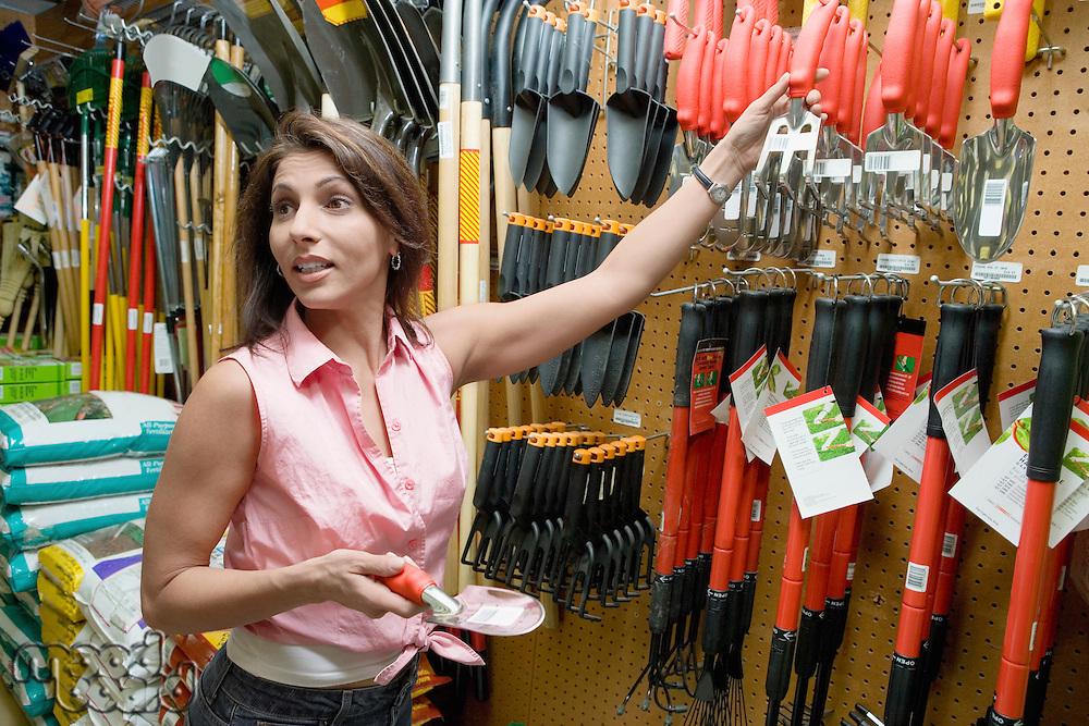 Woman Choosing Garden Tools