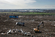 Landfill site owned by SITA, it is one of the largest sites in Europe stretching over 400 acres. In this particular section of the landfill, rubbish is brought to the site and is seperated by tractors. Packington, Warwickshire, UK. 2011