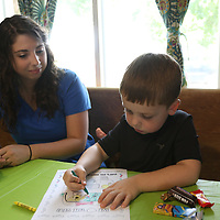 Emmett Rodgers, 4, colors a picture Saturday with Bridgett Hale at Tupelo Small Animal Hospital's open house