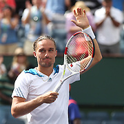 March 13, 2014. Indian Wells, California. Alexandr Dolgopolov defeats Milos Raonic in the quarterfinal of the 2014 BNP Paribas Open. (Photo by Billie Weiss/BNP Paribas Open)