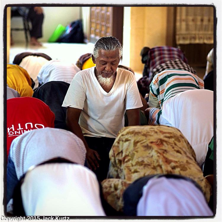 11 APRIL 2015 - BANGKOK, THAILAND:  A man prays at Ton Son Masjid (mosque) in the Thonburi section of Bangkok. Thailand has a large Muslim minority. PHOTO BY JACK KURTZ