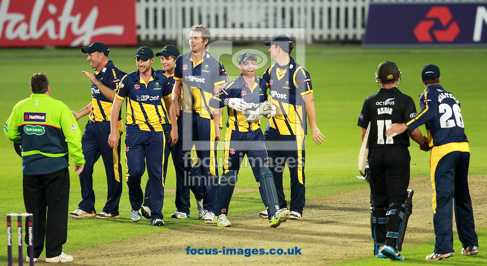 Glamorgan players celebrate the win over Surrey after the Natwest T20 Blast match at the Kia Oval, London<br /> Picture by John Rainford/Focus Images Ltd +44 7506 538356<br /> 11/07/2014