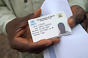 Man holding refugee id card at a UNHCR food distribution centre in the Ghanaian Volta region. Thousands of Togolese citizens crossed the border into Ghana after the violence that followed presidential elections in April 2005. Partly because of strong cultural ties between populations on both sides of the border, Togolese refugees were able to enjoy the relative hospitality of their Ghanaian neighbours, and are today scattered in various villages across the border. The UNHCR complains that, since the refugees aren't concentratred in large camps, media attention has been minimal, and that it has been very difficult to attract funding.