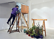 "© Licensed to London News Pictures. 15/11/2012. London, UK A woman looks inside a ""The perfect place to Grow"" by Tracy Emin, 2001. The Royal College of Art is celebrating its 175th anniversary with a major exhibition featuring more than 350 works of art and design by over 180 RCA graduates and staff, including Henry Moore, Barbara Hepworth, Tracey Emin, David Hockney, Peter Blake, Bridget Riley and Lucian Freud.  The RCA is the world's oldest art and design university in continuous operation. Its first students comprised a small group of teenage boys; today it educates some 1,200 postgraduate students from 55 different countries.. Photo credit : Stephen Simpson/LNP"
