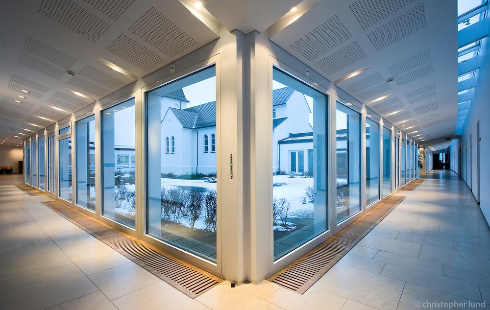 Congregation Hall at Keflavík Church. New building connected to the old church.?Won D.V. Cultural Award 2000. Size: 1000 m2. Constructed: 1996-2000. Safnaðarheimilivið Keflavíkurkirkju. Nýbygging sem tengist gömlu kirkjunni,?Menningarverðlaun D.V. 2000 Stærð: 1000m2. Byggingarár: 1996-2000.