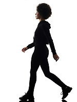 one mixed race african young teenager girl woman walking in studio shadow silhouette isolated on white background
