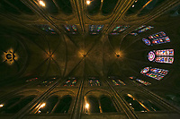 Notre Dame de Paris carhedral interior nave nave church window close up