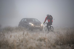 © Licensed to London News Pictures. 08/11/2019. London, UK. Commuters make their way through heavy fog at Richmond Park in west London on a bright Autumn morning. Parts of the north of England have experienced severe flooding following torrential rainfall. Photo credit: Ben Cawthra/LNP