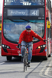 © Licensed to London News Pictures. 11/02/2020. London, UK. A cyclist and a bus in north London as Prime Minister, BORIS JOHNSON announces £5 billion new funding to improve bus services and cycle lanes across the country, which will transform with simpler fares, thousands of new buses, improved routes and higher frequencies. There will be at least 4,000 new Zero Emission Buses to make greener travel, driving forward the UK's progress on its net zero ambitions. Photo credit: Dinendra Haria/LNP