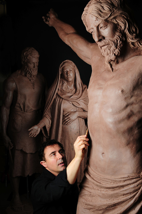 """Sculptor Rip Caswell works on """"the Crucifix""""  with  """"Mary & Joseph"""" in his studio. Mount Angel Abby, Benedict, Oregon."""