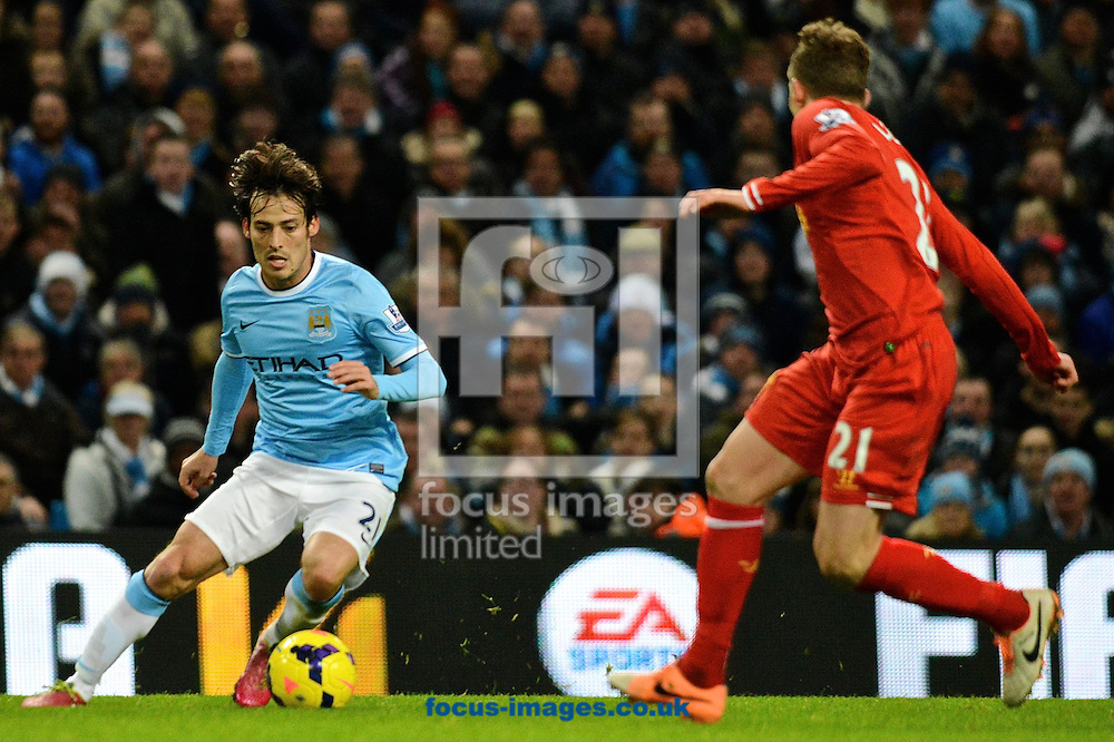 Picture by Ian Wadkins/Focus Images Ltd +44 7877 568959<br /> 26/12/2013<br /> David Silva of Manchester City take on Lucas Leiva of Liverpool during the Barclays Premier League match at the Etihad Stadium, Manchester.
