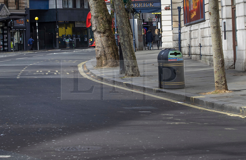 NOTE TO EDITORS - THIS IMAGE MATCHES WITH HISTORIC IMAGE no 010a RELEASED IN THIS POLL TAX FEATURE  © Licensed to London News Pictures. 25/03/2020. London, UK. Modern day locations of 1990 poll tax riot. Image matches with 'a protester throws a traffic bollard towards police advancing up Charing Cross Road'. The protest on the last day of March in 1990 started peacefully when thousands gathered in a south London park to demonstrate against Margaret Thatcher's Government's introduction of the Community Charge - commonly known as the poll tax. Marchers walked to Whitehall and Trafalgar Square where violence broke out with the trouble spreading up through Charring Cross Road and on to the West End. Police estimated that 200,000 people had joined the protest and 339 were arrested. The hated tax was eventually replaced by the Council Tax under John Major's government in 1992.  Photo credit: Peter Macdiarmid/LNP