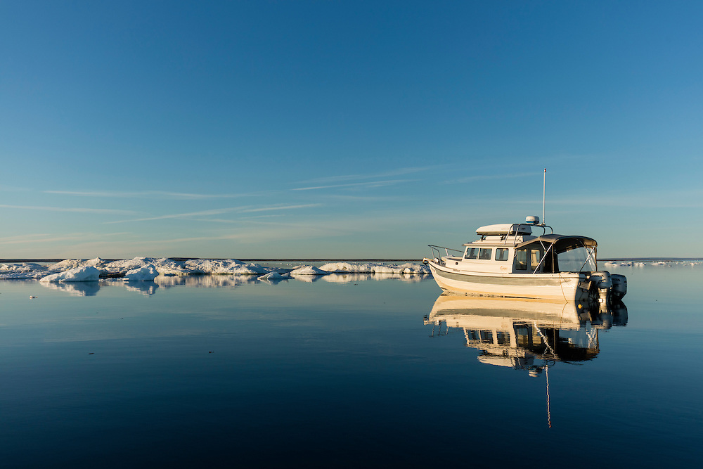 Canada, Nunavut Territory, Repulse Bay, C-Dory expedition boat and sea ice in Hudson Bay near Harbour Islands
