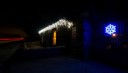East Lothian, Scotland, United Kingdom, 9th December 2019. Christmas decorations around the villages. Locals decorate their houses with a variety of lights and Christmas decorations. A small cottage by the roadside.<br /> Sally Anderson | EdinburghElitemedia.co.uk