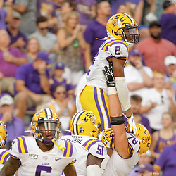 Aug 31, 2019; Baton Rouge, LA, USA; LSU Tigers wide receiver Justin Jefferson (2) celebrates with teammate offensive lineman Austin Deculus (76) after a touchdown against the Georgia Southern Eagles during the first quarter at Tiger Stadium. Mandatory Credit: Derick E. Hingle-USA TODAY Sports