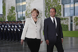 Bildnummer: 57992089..Chancellor Angela Merkel and Franois Grard Georges Nicolas Hollande Visit and Reception with military Honor the French Presidents in Federal Chancellery in Berlin Germany, Tuesday May 15, 2012