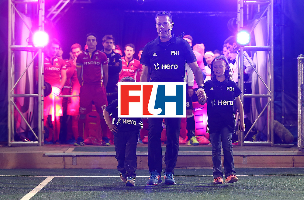 JOHANNESBURG, SOUTH AFRICA - JULY 23:  Umpire John Wright of South Africa walks out with his children officiating his last match during day 9 of the FIH Hockey World League Men's Semi Finals final match between Belgium and Germany at Wits University on July 23, 2017 in Johannesburg, South Africa.  (Photo by Jan Kruger/Getty Images for FIH)