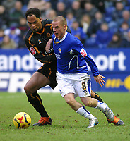 Photo: Dave Linney.<br />Leicester City v Wolverhampton Wanderers. Coca Cola Championship. 04/02/2006.Wolves defender Joleon  Lescott(L) tangles with   Iain Hume