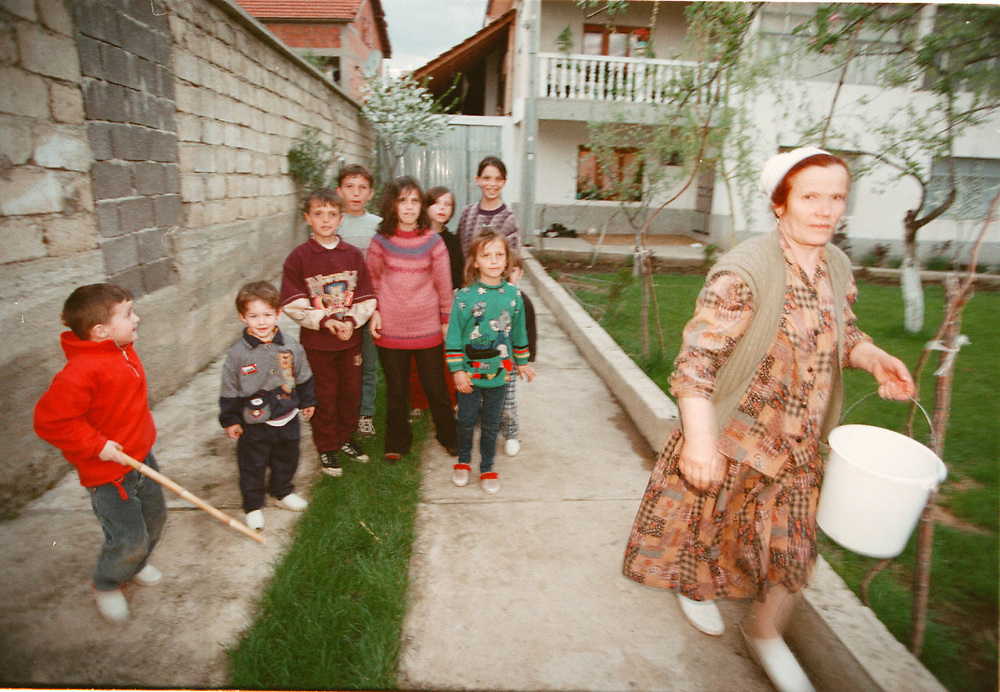 In the Macedonian village of Vaksince, 2 miles from the Kosovo border. 34 ethnic Albanian refugees (11 children and 23 adults) have been given refuge by Vehbi Fetahi, 56, and his three younger brothers. The compound's population has increased from 23 before the influx to 57 since their arrival. The Macedonian government does not provide welfare relief payments or food. Fetahi and his family provide all food and clothing.