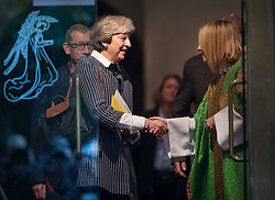 © Licensed to London News Pictures. 08/10/2017. Maidenhead, UK. Prime Minister Theresa May greets Reverend Kate Toogood (R) as she attends church in her constituency. Mrs May has faced heavy criticism after her disastrous conference speech, with some MPs in the Conservative party calling for her to stand down.  Photo credit: Peter Macdiarmid/LNP