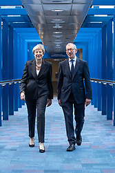 © Licensed to London News Pictures . 03/10/2018. Birmingham, UK. Prime Minister THERESA MAY and her husband PHILIP MAY cross the bridge from the Hyatt Regency Hotel to the Conference Centre ahead of the Leaders' speech . Day 4 of the Conservative Party conference at the ICC in Birmingham . Photo credit: Joel Goodman/LNP