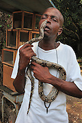 man holding a Close up of a boa constrictor
