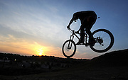 BRIGHTON - JUNE 12: Pat Costella rides down the dual slalom bike course at Mt. Brighton after the race as the sun sets Thursday June 12, 2014  in Brighton. The dual slalom bike races will be held during the resorts Thursday Mountain Club which also includes live music over the summer. (Photo by Bryan Mitchell/Special to The Detroit News)