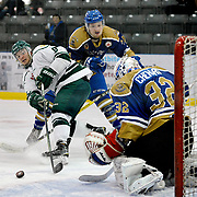 Elmira Sugar Kings forward Ethan Skinner shoots on Caledonia Corvairs' goalie Daniel Chenard during game 2 of the Sutherland Cup semi-final series on Sunday at the Dan Snyder Arena in Elmira. <br /> <br /> IAN STEWART / SPECIAL TO THE RECORD