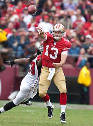 October 11, 2009; San Francisco, CA, USA;  San Francisco 49ers quarterback Shaun Hill (13) throws while being pressured by Atlanta Falcons cornerback Chris Houston (23) in the third quarter at Candlestick Park. Atlanta won 45-10.