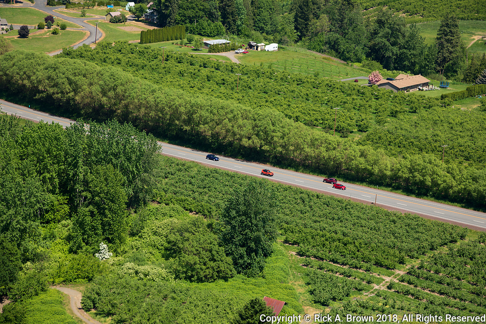 Traffic on a highway in the Hood River Valley from the air.