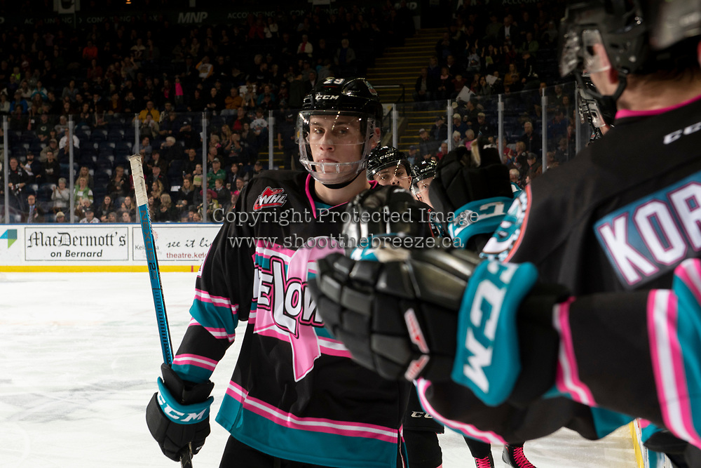 KELOWNA, CANADA - NOVEMBER 3: Nolan Foote #29 of the Kelowna Rockets fist bumps the bench after scoring a goal against the Brandon Wheat Kings  on November 3, 2018 at Prospera Place in Kelowna, British Columbia, Canada.  (Photo by Marissa Baecker/Shoot the Breeze)