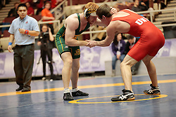 London, Ontario ---2013-03-02--- Morgan St. Laurent of The University Of New Brunswick takes on Drew Belanger of The University Of Alberta in the men's 68 KG 5th/6th match at the 2012 CIS Wrestling Championships in London, Ontario, March 02, 2013. .GEOFF ROBINS/Mundo Sport Images