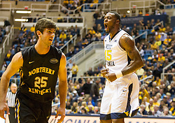 Nov 13, 2015; Morgantown, WV, USA; West Virginia Mountaineers forward Elijah Macon reacts after a dunk during the first half against the Northern Kentucky Norse at WVU Coliseum. Mandatory Credit: Ben Queen-USA TODAY Sports