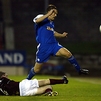St Johnstone v Arbroath..  09.11.02<br />Ian Maxwell jumps clear of this Darren Spink tackle<br /><br />Pic by Graeme Hart<br />Copyright Perthshire Picture Agency<br />Tel: 01738 623350 / 07990 594431