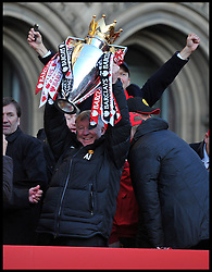 Sir Alex Ferguson lifts the Trophy as he addresses fans  in Albert Square, Manchester,  As Manchester United celebrate winning their 20th league title winning the Premier League, Monday May 13, 2013. Photo by: Andrew Parsons / i-Images