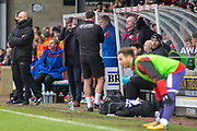 frustrated Scunthorpe United manager Graham Alexande in the dug out technical area during the EFL Sky Bet League 1 match between Scunthorpe United and Rotherham United at Glanford Park, Scunthorpe, England on 10 February 2018. Picture by Craig Zadoroznyj.