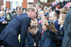 © Licensed to London News Pictures . 14/09/2017 . Liverpool , UK . The Duke of Cambridge , Prince William , is greeted by children from Northcote Primary School during a visit to Life Rooms in Walton . Life Rooms provides community support to help people recover from mental health issues . Photo credit : Joel Goodman/LNP