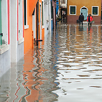 Locals walk along flooded lanes in Burano. More than 59% of Venice was under water on Thursday, as the historic lagoon town was hit by exceptionally high tides. The sea level rose above 140cm overnight and was expected to remain above critical levels for about 15 hours.