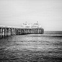 Malibu Pier black and white picture in Malibu California. Malibu Pier is a historic landmark along the Pacific Ocean in Los Angeles County.