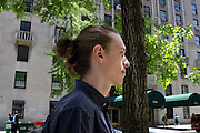 "May 15, 2015 - New York, NY. ""I just like having long hair. I've had the bun before anyone else,"" said Tom Conroy, 24. 05/15/2015 Photograph by Alexa R. Pipia/NYCity Photo Wire"